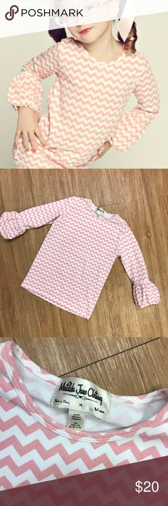 "Matilda Jane Adahleen Louise Pink Puffer Top 10 Matilda Jane Adahleen Louise Pink Puffer Top 10 Chevrons Good Hart  Super cute top in very good overall condition with the exception of some faded spots on the sleeves.  Not going to be super noticeable on.  Cotton/spandex blend.  18.75"" long 13.5"" p to p flat Matilda Jane Shirts & Tops"