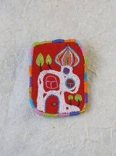 I'm a big Hunderwasser fan so I think these little embroidered brooches are gorgeous. ( I wish I'd thought of it )