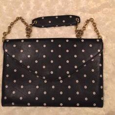 EUC J Crew Envelope Clutch Black / Polka Dots J Crew Envelope Clutch Black & White Polka Dots. 3 Large openings to put your things. I use this style and love it. It holds everything.  The gold chain link strap with comfort leather top just adds to the beauty. J. Crew Bags Clutches & Wristlets