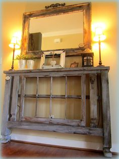 entryway tables made from deck post with a reclaimed window frame centerpieces painted and distressed for an aged patina greet guest with rustic charm