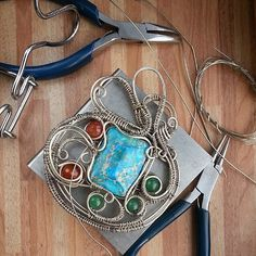 Nickel silver pendant with varistsitom, carnelian, chrysoprase.