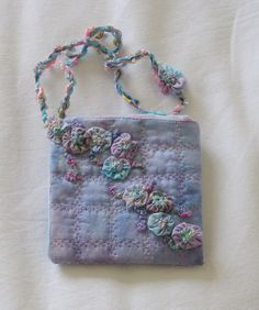 Small quilted bag with Suffolk Puffs by free style girl, via Flickr