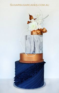 Beautiful cake! Navy, copper and marble!