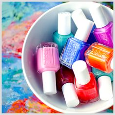 Essie nail polishes, one of my all time fave nail brands. I also put my polishes in cups/containers/bowls. Such a pretty picture!