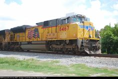 Locomotive: UP 8467(SD70ACe) Date: 7/14/2011 Location: Jacksonville, FL. Collection Of:   Adam Finger.  Locomotives: UP 3778 (SD70M) Date: 4/10/2015 Location: Franklin Grove, IL. -  May 16, 2007, UP 3778 (SD70M) leading UP 8467 (SD70ACe), was  involved in a collision/derailing at Nisqually, Washington, with UP 5261 (GE ES44AC) which UP 5261, along with UP 7634 (ES44AC GE), slid down the embankment and  ended up partly on the road at the bottom.