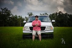 Photo from Ty Galliher 2014 Senior collection by Jamie Good Photography.  Senior with truck in a field.