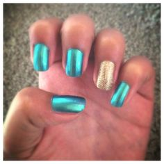 "They look like cool ""Egyptian"" nails to me! Turquoise and gold nails."