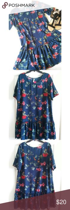 """Tropical Casual Dress Cute flowy dress with beautiful flower print throughout. Tag shows color as Navy but I think it looks like a dark green-blue color. No lining underneath.  *Measurements* Length: 36"""" inches Width: 22"""" inches (laying flat) Sleeve: 12"""" inches Xhilaration Dresses Mini"""