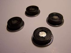 Using old coins and plastic spacers with rare earth magnets so the magnets aren't QUITE so damn powerful...