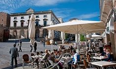 Bars in Cáceres, such as this one in Plaza Mayor, usually offer a free tapa with your drink.