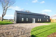 Stunning barn conversion at Bressingham by award-winning Nest Development Barn Conversion Exterior, Barn House Conversion, House Cladding, Exterior Cladding, Contemporary Barn, Modern Barn, Country Farmhouse Exterior, Steel Barns, Luxury Modern Homes