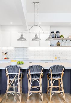 A dated kitchen and dining space is transformed into a beloved Hamptons haven with rattan blue bar stools, a blue and white kitchen island and white subway tiles. #hamptons #hamptonstyle #hamptonskitchen #coastalkitchen Hamptons Kitchen, The Hamptons, Renovation Budget, White Kitchen Island, White Subway Tiles, House Inside, Window Styles, Exterior House Colors, Kitchen Styling