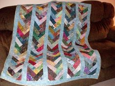 Batik Friendship Braid Quilt, needs darker border.  Can make this with my scraps of Batik for bedroom.