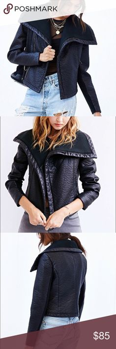 Pins and Needles vegan leather jacket Edgy textured vegan leather moto jacket with tonal ribbed knit insets along the spread collar and the underside of sleeves. Sold only at Urban outfitters. In a fitted silhouette with covered zip closure, zippered pockets and silky lining throughout.  In excellent used condition ✨🎈  CONTENT + CARE  - Rayon, polyester, polyurethane; acrylic  - Spot clean  - Imported Pins & Needles Jackets & Coats