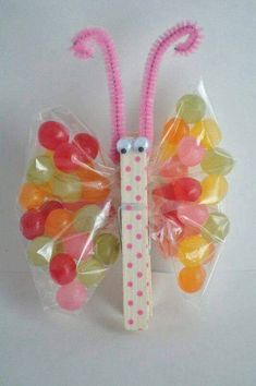 Jellybean butterfly made with clothespin, googly eyes, chenille stem for antenna, and wings made from sandwich bag and jellybeans. Too cute!