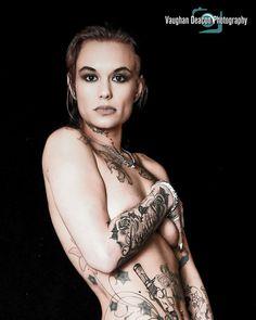 Implied nude glamour portrait of tattooed model