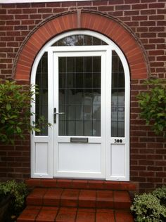 A lovely arched door installation by CES Windows, tweeted to us at our account @REHAU North America Windows UK #upvc #windows #upvc #doors #CESwindows Arched Front Door, Brown Front Doors, Double Front Doors, Wood Front Doors, Arched Doors, Oak Doors, Porch Doors Uk, Porch Uk, House Doors