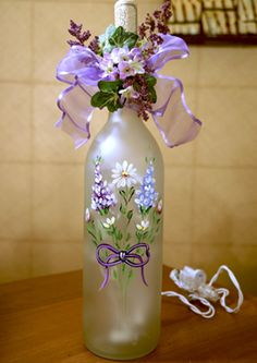 Spring Bouquet Bottle by Tami Carmody As winter finally draws to an end, you can light up Daylight Savings Time with Tami Carmodys Spring Bouquet. Never fear painting on glass again: a light touch and a lot of color are the keys to working with enamel. Wine Bottle Glasses, Wine Bottle Corks, Glass Bottle Crafts, Diy Bottle, Painted Wine Bottles, Lighted Wine Bottles, Painted Wine Glasses, Decorated Bottles, Glass Bottles