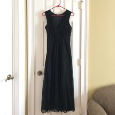Formal Black Evening Gown Beautiful Black formal floor length dress. It's a Scott McClintock, a line from Jessica McClintock from the late 80's. It's in fab condition, but I would suggest getting it dry cleaned because it has been sitting for so long without wearing and it's a little wrinkly. Beautiful black material with silver flecks that reflect with light. Back of neckline has row of rhinestones. Side zipper. Shell: 75% Acetate, 25% Mylar. Lining: 100% Acetate. Dry clean only, made in…