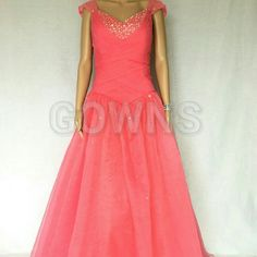 Beautiful Ball Gown Organza Ball Gown in Watermelon Color. Absolutely stunning! This evening gown comes in many sizes. Please inquire with any and all questions you may have about sizes! Gowns Dresses