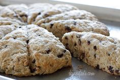 Skinny Chocolate Chip Buttermilk Scones - Buttermilk scones sweetened just to perfection studded with chocolate chips. Kind of like eating a giant chocolate chip cookie for breakfast... without the guilt.  Yes, I just found my new favorite scone!