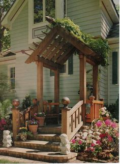 side porch with pergola | love this small pergola covering the bench.