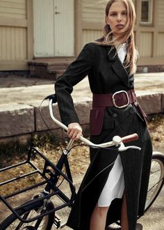 & Other Stories. Big belt buckle, long coat and bicycle perfect autumn style staples via velondonista.com