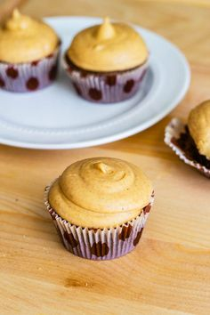 Fudgy Brownie Cupcakes with Pumpkin Cream Cheese Frosting - an easy recipe by sallysbakingaddiction.com