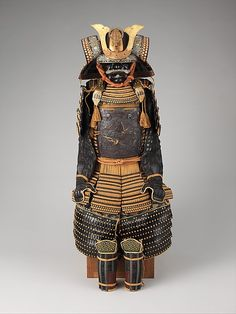 Armor (Gusoku). Date: late 18th–19th century. Iron, lacquer, gold, silver, copper alloy, leather, silk. As mounted: H. 54 1/2 in. (138.4 cm); W. 22 1/2 in. (57.2 cm); D. 20 1/2 in. (52.1 cm). -The Metropolitan Museum-
