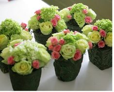 Maybe this but with a small blue flower instead of pink? Or just a more subtle pink Small Centerpiece.  Looks like 1 hydrangea, 5 larger roses and a bunch of mini roses.