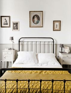 love this antique metal / cast iron bed. and love the mis-matching bedside tables. I'm toying with that idea for our room!