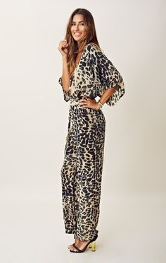 BLU MOON KIMONO SLEEVE JUMPER This jumpsuit features a tie dye leopard pattern, crossover bodice with V-neck, 3/4 length sleeves, an adjustable tie at waist and wide leg pant silhouette. Pair with strappy heels and minimal jewelry for a chic outfit.