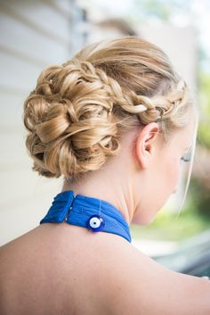 Braided curled low bun: http://www.stylemepretty.com/2016/09/21/blue-ivory-greek-chicago-wedding/ Photography: Elizabeth Nord - http://elizabethnord.com/