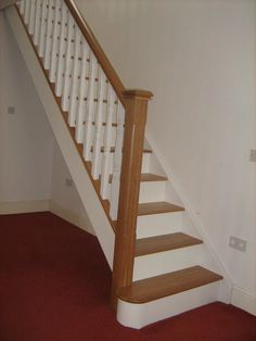 Oak and white staircase with white spindles. Would painting just the risers help as an update or would I have to do spindles too? Painted Stair Railings, Stairs Balusters, Diy Stair Railing, Oak Handrail, Interior Stair Railing, Oak Stairs, Painted Stairs, Basement Stairs, House Stairs