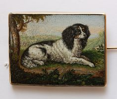 A fine micromosaic made of tiny glass threads (tesserae) in different shapes and shades representing a spaniel (Prince Charles) signed: AF for Francescangeli Agostino, Rome circa 1830.