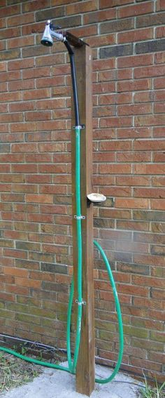 http://www.homejelly.com/how-to-make-outdoor-shower-using-garden-hose/