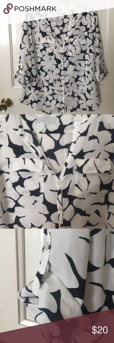 Flowered New York and Company shirt Rarely worn in great condition.     100% Polyester New York & Company Tops Blouses