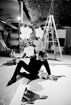 Andy Warhol working on a 'Flower' painting at The Factory, New York, March 1965