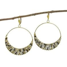 Square-shaped metallic glass beads in silver, gold, and gunmetal fill in a crescent at the base of these edgy hoop earrings. With hinged easel backs, these earrings measure 2.25 inches in diameter.