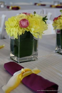 Bright Yellow and Accented Pink Dahlia and Ranunculi Centerpieces