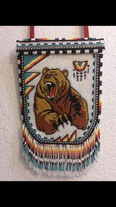 Awesome ghost bead backing grizzly bear pouch- wide by long. American Indian Crafts, Native American, Bead Loom Patterns, Beading Patterns, Bear Signs, Medicine Bag, Nativity Crafts, Native Beadwork, Beaded Bags