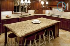 Santa Cecilia granite provides a consistent pattern and an element of contrast throughout the island and main counters.