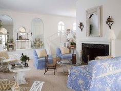 "A light and airy living room in a Palm Beach townhouse. Vintage rattan furniture mixes well with #upholstered and #antique pieces. @quadrillefabrics ""Lyford Background"" on the sofa, facing two chairs in @romo_newyork . Pillows in #chinaseasfabric ""Aga"" play against ""Aga Reverse"" which is covering the cushions of the #vintagerattan chairs. Baguès standing lamps with woven paper shades flank the fireplace. Antique pieces and English #woolpit lamps bring darker tones that are accentuated by the…"