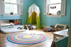 Playroom Ideas. First... the rug. I really want to make one. Second... the sleep mat with a simple sheet, and an inexpensive closet mirror hung lengthwise on the wall!