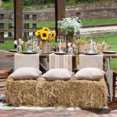 Rustic table with seats on hay bales