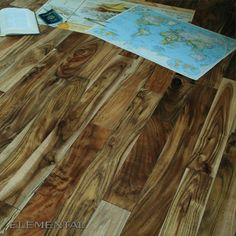 Natural Acacia hardwood is vibrant, complex, and always a popular flooring material with forward-thinking designers.