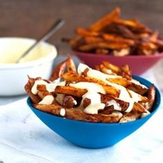 Baked Spicy Fries with Garlic Cheese Sauce - and less than 300 calories per serving.