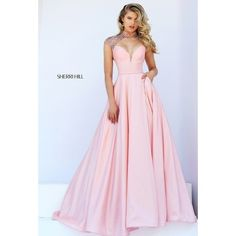 This Sherri Hill ballgown is absolute perfection. The deep V neckline beautifully compliments the illusion high neck. And, it has pockets! View Size Chart