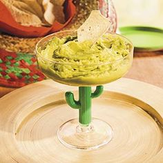 "Fiesta Cinco de Mayo Party Guacamole Recipe.  With the sharp accent of lime juice, this delightfully simple guacamole recipe will have all your fiesta guests shouting ""Ayiyi""! Serve your tortilla chips in an overturned sombrero and your guacamole in a cactus margarita glass for a truly festive chip and dip spread."