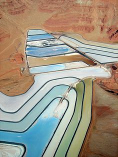 The Colorado River has been the misused lover of many a mining corporation and troubled politician — but beauty always has a way of gracing even the most violent and unfortunate human offenses. It's uncomfortable and comforting and discomfiting and sort of otherworldly when it does. Here, an aerial view,from Boulder photographerJesse Varner,of evaporation ponds at the Potash Plant near Moab, Utah.Salts are mined and pumped up from deep below the surface, and the solution is conce